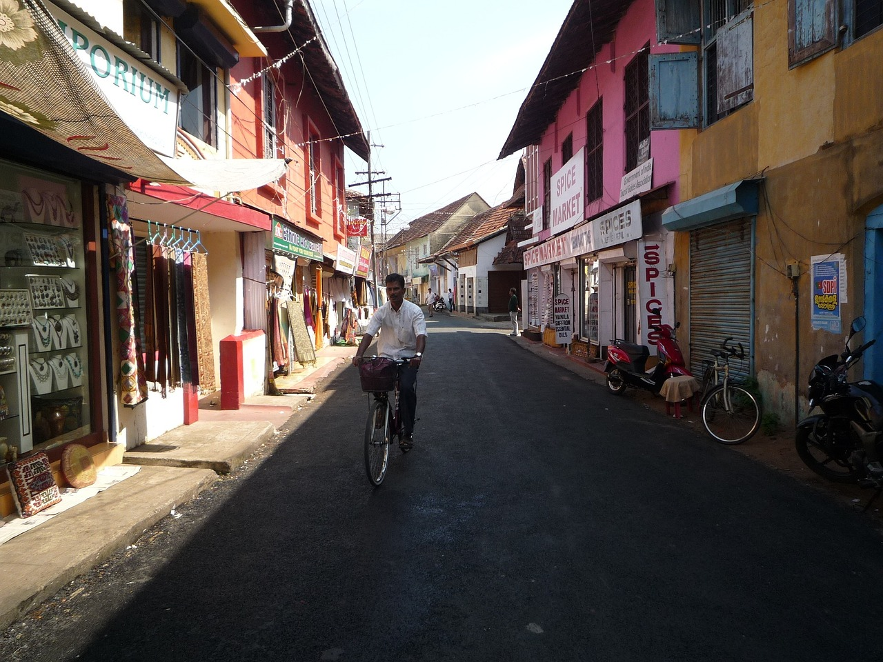 man cycling through the wall street in Kochi, Kerala