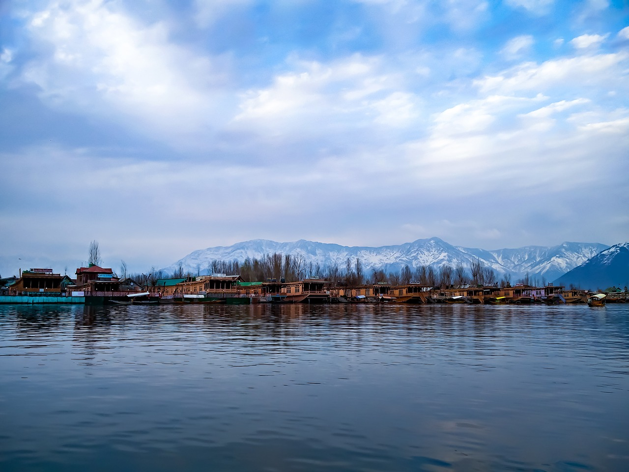 a lake and behind a white snowy landscape in Srinagar