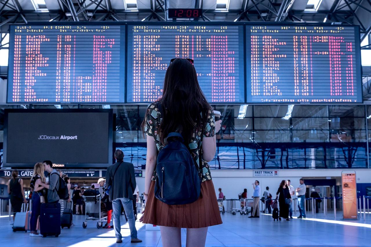 woman at airport | Taj Travel