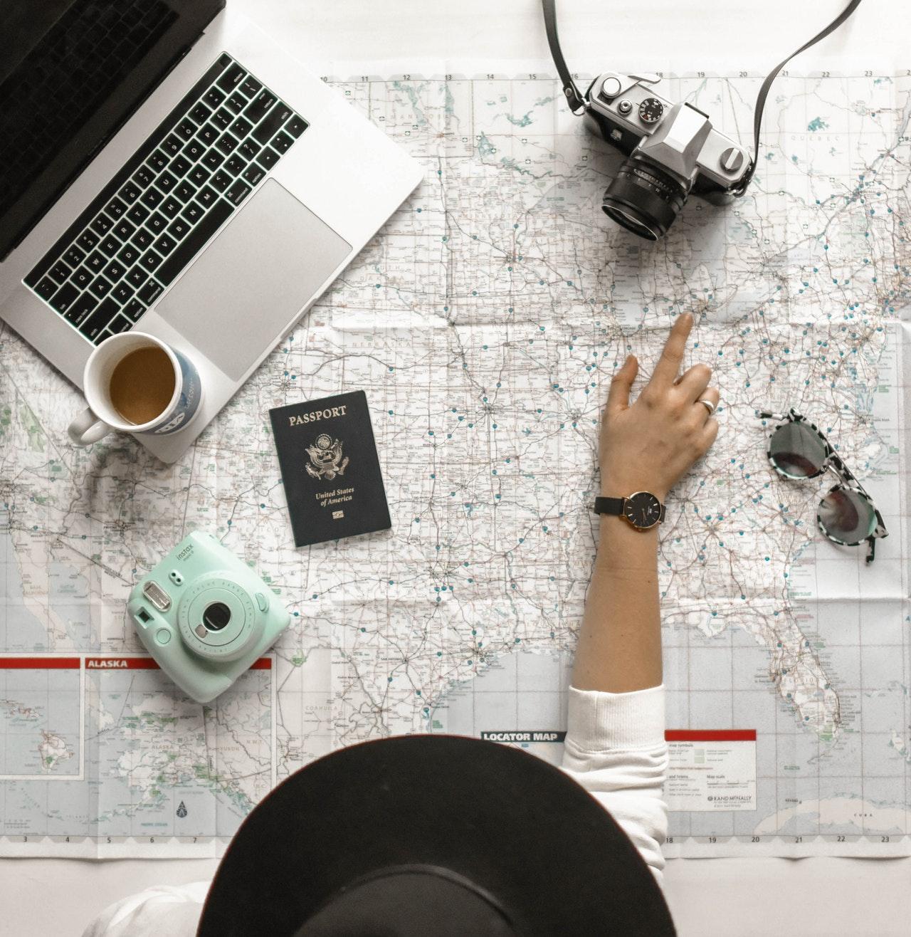 woman with gadget and passport |Taj Travel