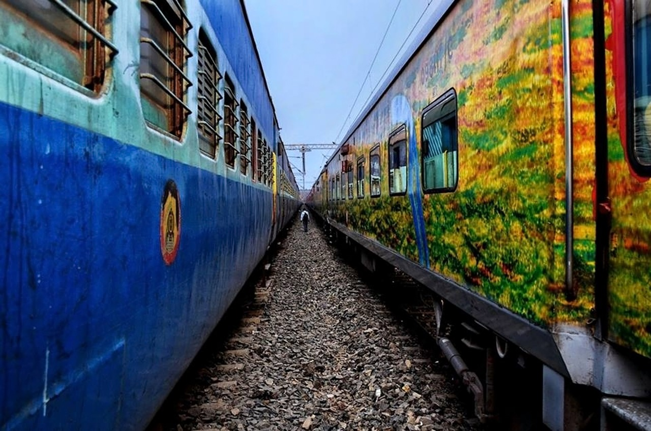 a view between two trains in Indian Railway